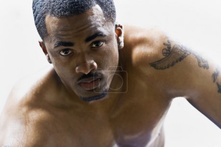 Bare-chested African American man