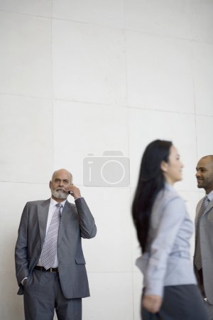 Senior African businessman talking on cell phone