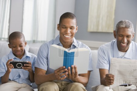 """""""African American grandfather, father and son relaxing"""""""