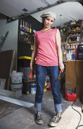 Middle Eastern woman in home workshop