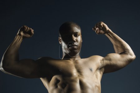African American man flexing muscles