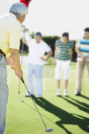 Senior Asian man playing golf