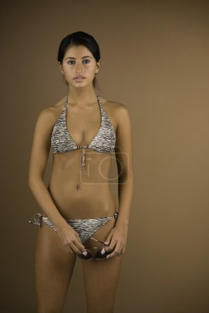 Mixed Race woman wearing bikini