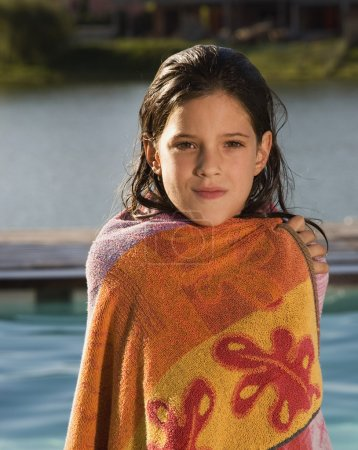 Hispanic girl wrapped in towel