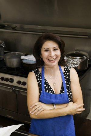 Hispanic woman in commercial kitchen