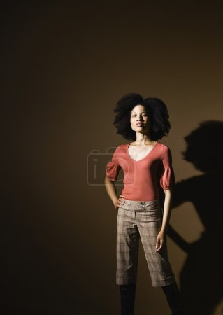 African American woman with hand on hip