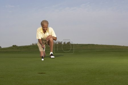 Senior African American woman playing golf