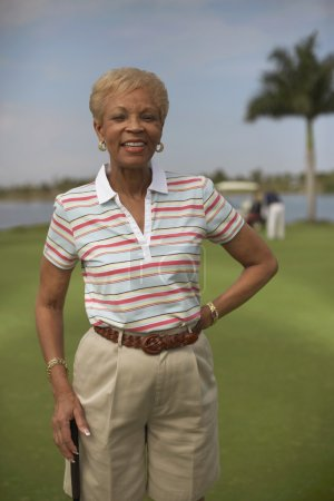 Senior African American woman on golf course