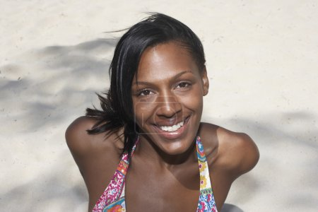Mixed Race woman on beach