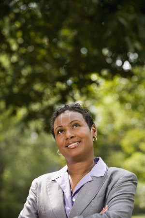African American businesswoman looking up