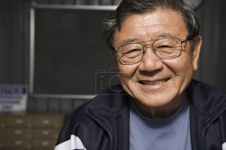 Senior Asian man wearing eyeglasses
