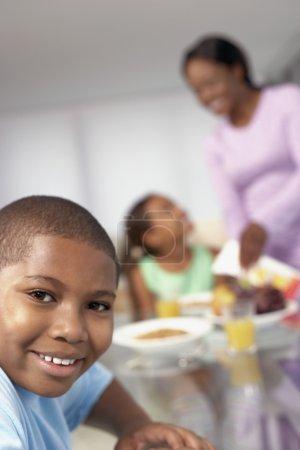 African American boy a breakfast table