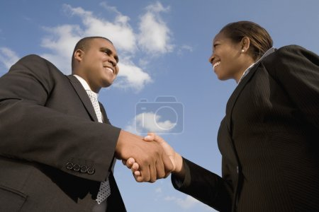 African businesspeople shaking hands