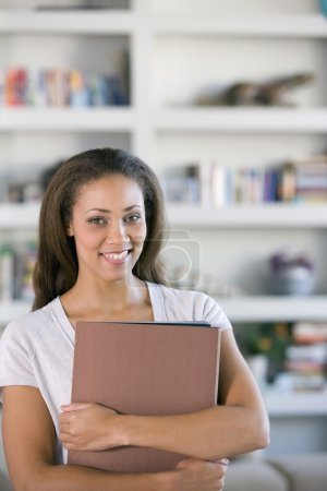 African American woman holding folders