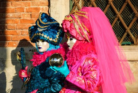 Two masks during traditional Carnival.