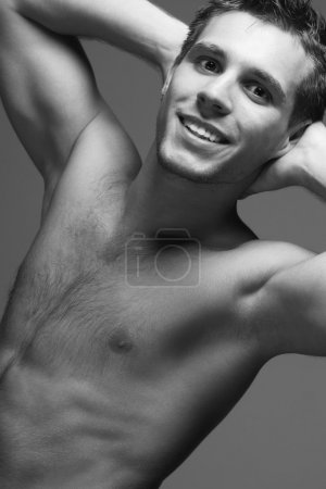 Male beauty concept. Portrait of handsome muscular male model po
