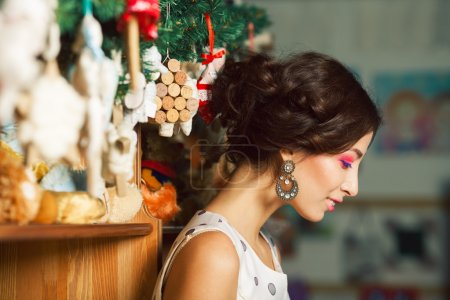Christmas shopping concept. Emotive portrait of happy beautiful