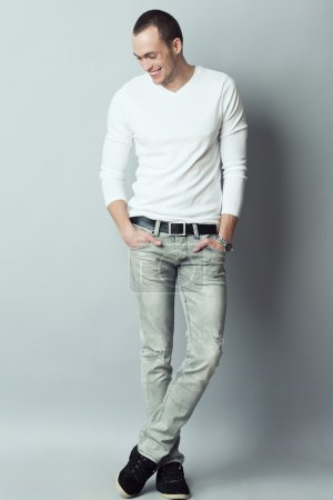 Male fashion concept. Fashionable young man with haircut wearing