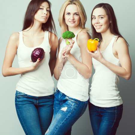 Happy veggies concept. Group portrait of healthy young women in