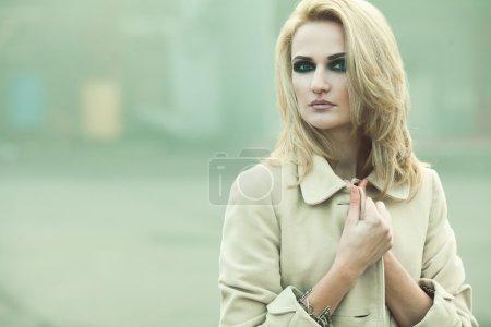 Decent aristocracy concept. Emotive portrait of beautiful girl in coat