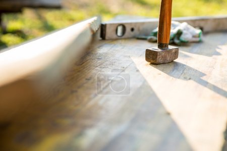 Mallet and builders level on a patio