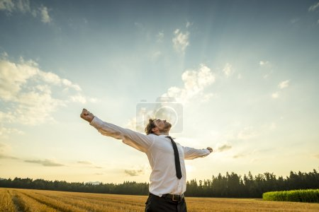 Thankful Businessman with Open Arms at the Field