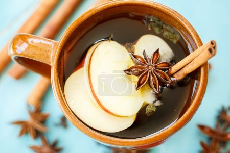 Apple tea with spices in a cup