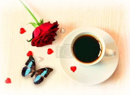 cup of coffee, butterfly and roses for Valentine's Day