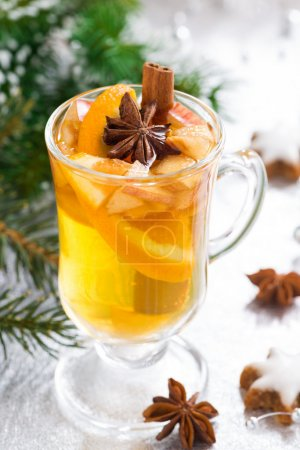 Spicy Christmas apple cider on a silver background