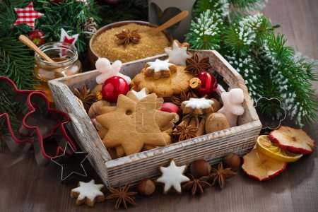 Photo for Wooden box with Christmas cookies on the table, horizontal - Royalty Free Image