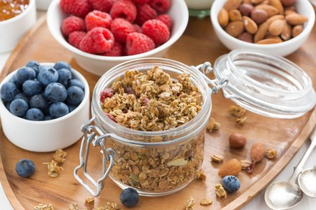 glass jar with homemade granola and berries