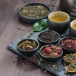 Assortment of fragrant dried teas and green tea on...