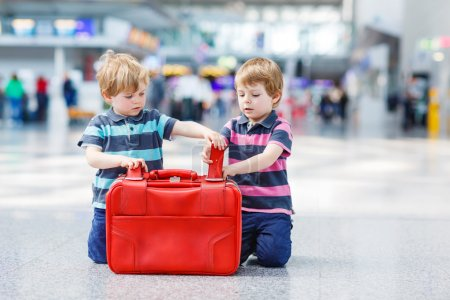 Two brother boys going on vacations trip at airport