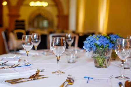Table set in blue and white for wedding or event party.