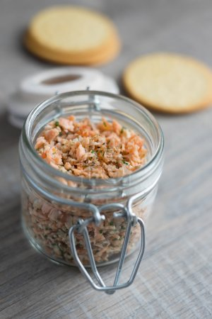 Salmon pate with smoked and roasted fish, onion, mayo in a jar, selective focus