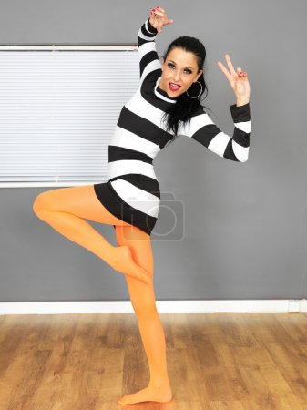 Sexy Young Woman Wearing a Mini Dress with Orange Tights