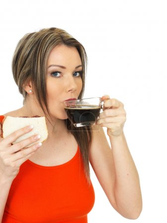 Young Woman With a Black Coffee and Bacon Sandwich