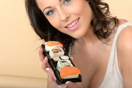 Young Woman Eating Japanese Style Sushi