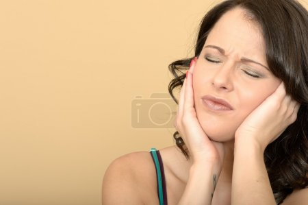 Attractive Young Woman With a Painful Toothache