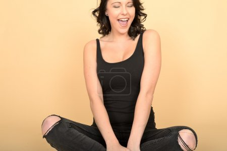 Attractive Sexy Young Woman Wearing Black Jeans and Vest Top