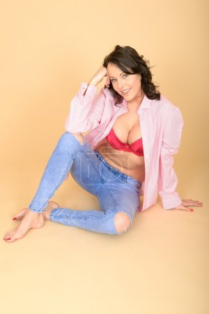 Photo for Attractive Young Sexy Woman Wearing Jeans and Shirt Revealling Her Red Bra Lingerie - Royalty Free Image
