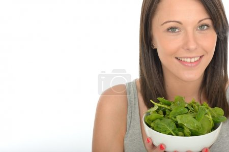 Attractive Healthy Young Woman Holding A Bowl of Spinach