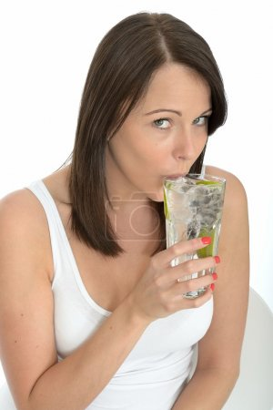 Healthy Young Woman Holding a Glass of Iced Water