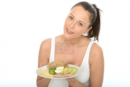Healthy Young Woman Holding a Plate of a Typical Norwegian or Sc