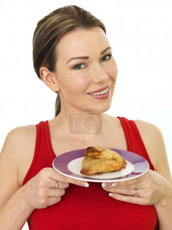 Attractive Young Woman Holding a Plate of Indian Style Samosa Snacks