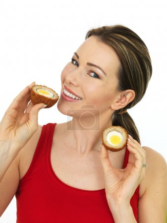 Happy Attractive Young Woman Holding a Cooked Scotch Egg Savory Snack