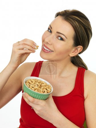Attractive Young Woman Holding Salted Roasted Peanuts