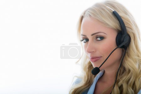 Attractive Young Business Woman Using a Telephone Headset