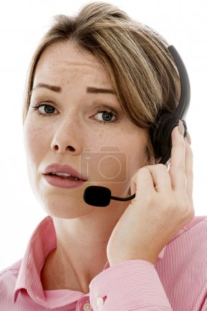 Photo for Attractive Young Business Woman Using a Telephone Headset Making Sales Calls or Marketing Against a Plain White Background - Royalty Free Image
