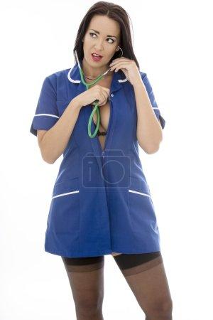 Sexy Young Pin Up Model Wearing A Nurses Uniform In Pin Up Glamo